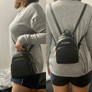 MK MINI CROSSBODY/BACK PACK